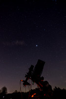 Single image of telescope and stars behind it. The bright one in the center is Jupter